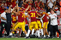 LOS ANGELES, CA - SEPTEMBER 8: USC Trojans celebrate after an interception during a game between USC and Stanford Football at Los Angeles Memorial Coliseum on September 7, 2019 in Los Angeles, California.