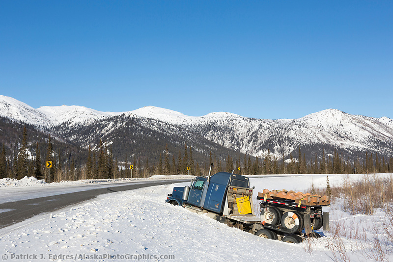 Truck in the ditch along the icy James Dalton Highway in winter.