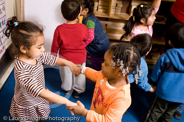 Educaton preschool  3-4 year olds movement dancing exercise group of children dancing to music horizontal