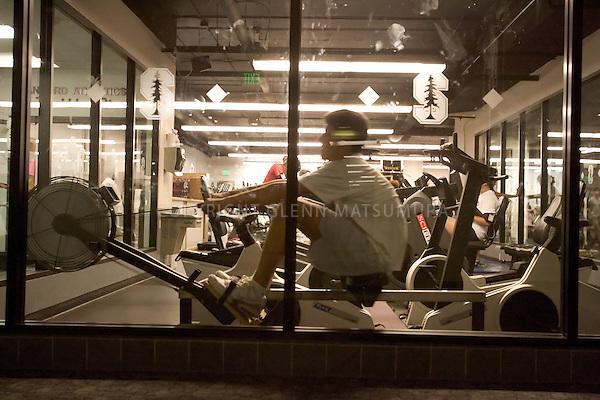 Stanford after dark. Stanford Freshman Armon Shaei on rowing machine at Stanford