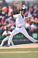 South Carolina starting pitcher Jack Wynkoop (13) delivers a pitch during a game against the Clemson Tigers at Fluor Field February 28, 2015 in Greenville, South Carolina. The Gamecocks defeated the Tigers 4-1. (Tony Farlow/Four Seam Images)