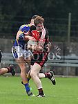 St Kevins Seanie Crosbie Bracknagh Stefan Geoghegan. Photo:Colin Bell/pressphotos.ie