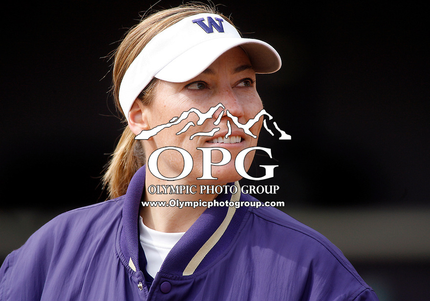 14 March 2010:  Washington Huskies head coach Heather Tarr watches her team warm up before the game against Seattle University. Washington defeated Seattle University 8-3 at Husky Softball Stadium in Seattle, WA.