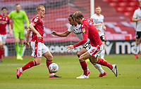 7th July 2020; City Ground, Nottinghamshire, Midlands, England; English Championship Football, Nottingham Forest versus Fulham; Bobby Reid of Fulham flanked by Ben Watson   and Joe Worall of Notts Forest
