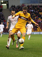 Shaun Hutchinson being pressured by Gavin Rae in the Motherwell v Aberdeen, Clydesdale Bank Scottish Premier League match at Fir Park, Motherwell on 26.12.12.