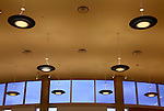 An Architectural Interior Image - Ceiling Lights and A Row Of windows Near The Ceiling.