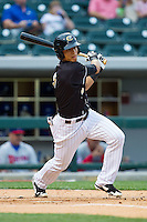 Gorkys Hernandez (9) of the Charlotte Knights follows through on his swing against the Buffalo Bisons at BB&T Ballpark on May 9, 2014 in Charlotte, North Carolina.  The Knights defeated the Bisons 5-3.  (Brian Westerholt/Four Seam Images)