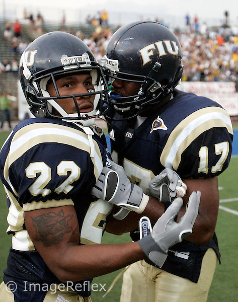 Lionell Singleton of Florida International is congratulated by Robert Mitchell during the game against Bowling Green on September 16, 2006, at FIU Stadium in Miami, Florida.  Bowling Green won the game 33-28...