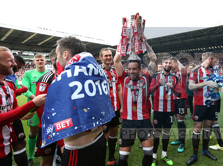 Sheffield United's Samir Carruthers celebrates with the trophy during the League One match at Bramall Lane, Sheffield. Picture date: April 30th, 2017. Pic David Klein/Sportimage