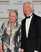 United States Senator Thad Cochran (Republican of Mississippi) and an unidentified guest arrive for the formal Artist's Dinner at the United States Department of State in Washington, D.C. on Saturday, December 4, 2010..Credit: Ron Sachs / CNP.