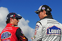 Nov. 14, 2008; Homestead, FL, USA; NASCAR Sprint Cup Series driver Jeff Gordon (left) talks with teammate Jimmie Johnson during qualifying for the Ford 400 at Homestead Miami Speedway. Mandatory Credit: Mark J. Rebilas-