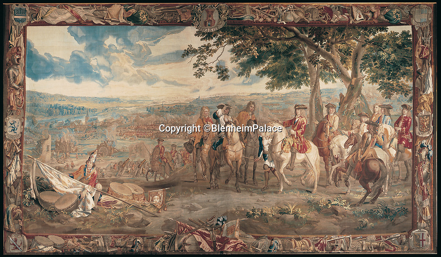 BNPS.co.uk (01202 558833)<br /> Pic: Blenheim/BNPS<br /> <br /> The Battle of Blenheim tapestry shows Marshall Tallard (Centre) surrendering to Marlborough (White horse) as a Grenadier Guard furls the captured French Royal flag (right)..<br /> <br /> Blenheim Palace prepares to pay its Royal dues&hellip;.Historic standard of the 'Sun King' is presented annually to the Queen in lieu of rent.<br /> <br /> The 300 year old tradition will be upheld this week when officials from Blenheim Palace travel to Windsor Castle.<br /> <br /> Each year representatives of the Duke of Marlborough present a French royal standard to the Superintendent of the Castle in lieu of rent.<br /> <br /> Only Blenheim Palace and the Duke of Wellington's estate at Stratfield Saye are afforded the 'Quit rent standard' in thanks for their respective victories over the old enemy, France.<br /> <br /> Blenheim's standard is always presented in the week leading up to the anniversary of the First Duke&rsquo;s historic victory over Louis XIV at the Battle of Blenheim on August 13, 1704.<br /> <br /> Although Blenheim Palace was paid for by public subscription, the land it is on was a former Royal hunting lodge and in theory if the standards are not delivered the Queen could reclaim her former estate.