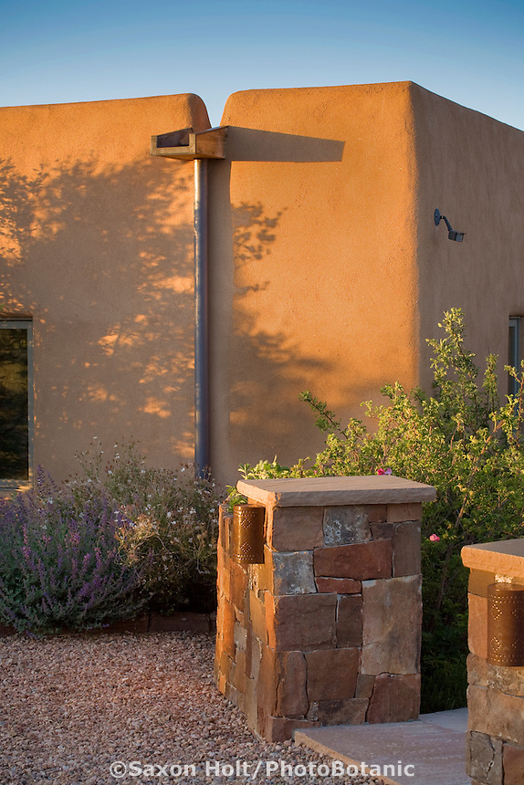 Roof water downspout into cistern in New Mexico xeriscape, drought tolerant garden