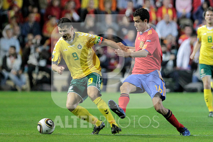 Lithuania's Tomas Danilevicius (l) and Spain's Sergio Busquets during UEFA Eurocup 2012 qualifying match.October 8,2010. (ALTERPHOTOS/Acero)