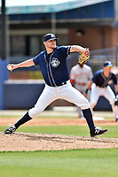Asheville Tourists pitcher Bryan Baker (33) delivers a pitch during a game against the Greenville Drive at McCormick Field on April 16, 2017 in Asheville, North Carolina. The Drive defeated the Tourists 4-2. (Tony Farlow/Four Seam Images)