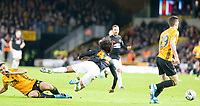 4th January 2020; Molineux Stadium, Wolverhampton, West Midlands, England; English FA Cup Football, Wolverhampton Wanderers versus Manchester United; Romain Saiss of Wolverhampton Wanderers fouls Tahith Chong of Manchester United leading to a yellow card from Referee Paul Tierney  - Strictly Editorial Use Only. No use with unauthorized audio, video, data, fixture lists, club/league logos or 'live' services. Online in-match use limited to 120 images, no video emulation. No use in betting, games or single club/league/player publications