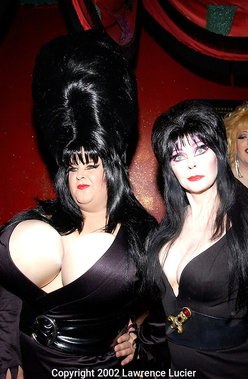 NEW YORK-SEPTEMBER 13: Actress Cassandra Peterson aka Elvira (R) and costume designer Chris March arrive for the premier party for Peterson's new film Elvira's Haunted Hills September 13, 2002, at Lucky Chengs Restaurant in New York City. The film is directed by Sam Irvin.