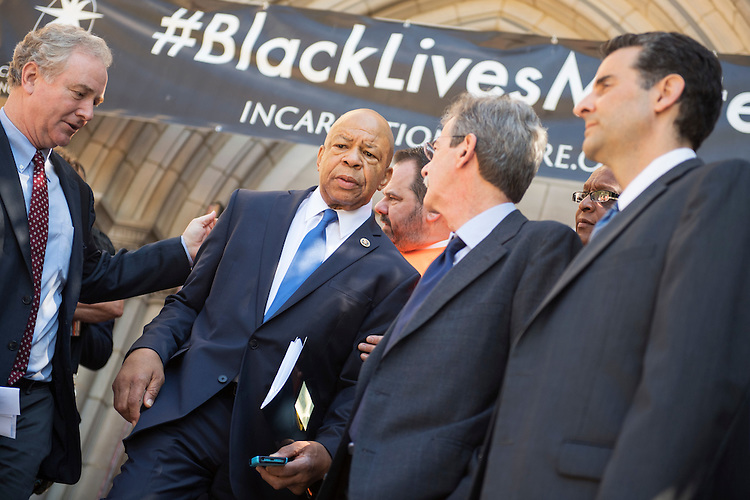 UNITED STATES - JUNE 29: Reps. Elijah Cummings, D-Md., center, Chris Van Hollen, D-Md., left, and John Sarbanes, D-Md., right, attend a rally with lawmakers and gun violence victims to call for action on gun safety measures on the steps of the Cathedral of the Incarnation in Baltimore, Md., June 29, 2016. (Photo By Tom Williams/CQ Roll Call)