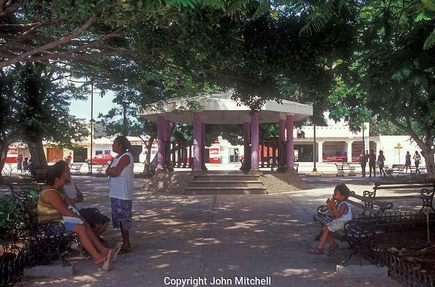 People relaxing in the main square in the village of Celestun, Mexico