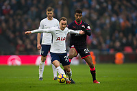 Tottenham Hotspur's Christian Eriksen holds off the challenge from Huddersfield Town's Steve Mounie <br /> <br /> Photographer Craig Mercer/CameraSport<br /> <br /> The Premier League - Tottenham Hotspur v Huddersfield Town - Saturday 3rd March 2018 - Wembley Stadium - London<br /> <br /> World Copyright &copy; 2018 CameraSport. All rights reserved. 43 Linden Ave. Countesthorpe. Leicester. England. LE8 5PG - Tel: +44 (0) 116 277 4147 - admin@camerasport.com - www.camerasport.com