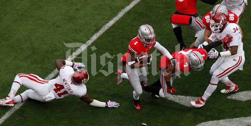Ohio State Buckeyes running back Dontre Wilson (1) goes up against Indiana Hoosier at Ohio State Stadium in Columbus  Nov. 23, 2013.
