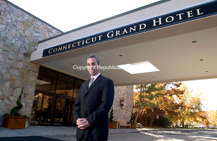 WATERBURY, CT - 28 October 2004 - 102804TH09 -   _____________ , general manager of the Connecticut Grand Hotel and Conference Center on East Main Street in Waterbury poses at the main entrance of the newly opened business.     Todd Hougas Photo