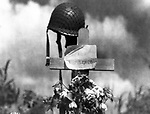 Inscription written in French on this grave of an American soldier made by French civilians in France on June 18, 1944. The soldierís helmet tops the wooden cross. The American died in the fighting with allied troops fighting for the Cherbourg Peninsula. (AP Photo)