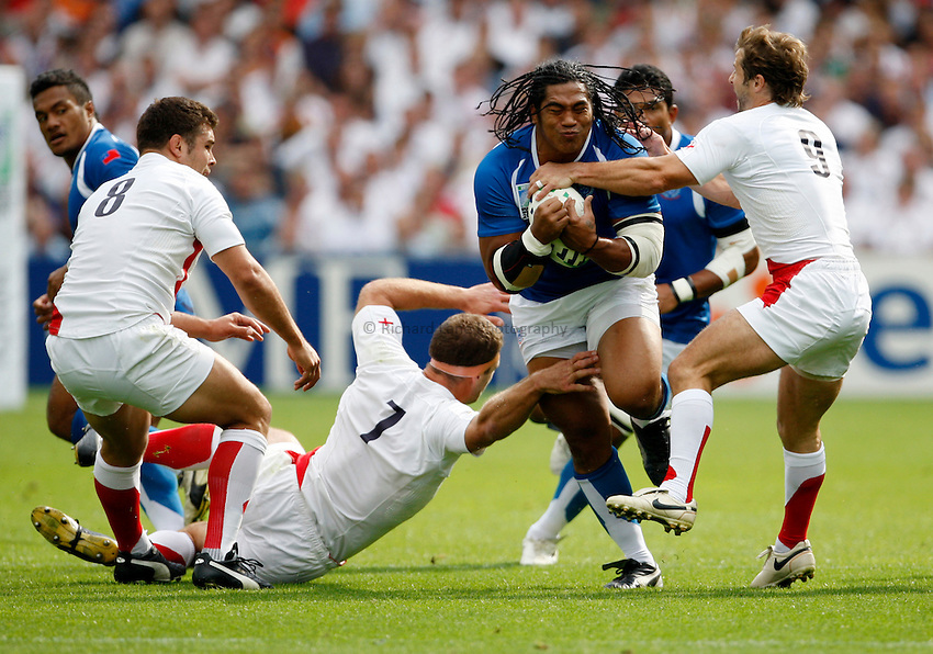 Photo: Richard Lane/Richard Lane Photography..England v Samoa. Pool A, IRB Rugby World Cup, RWC 2007. 22/09/2007. .Samoa's Henry Tuilagi is tackled by England's Joe Worsley and Andy Gomarsall.