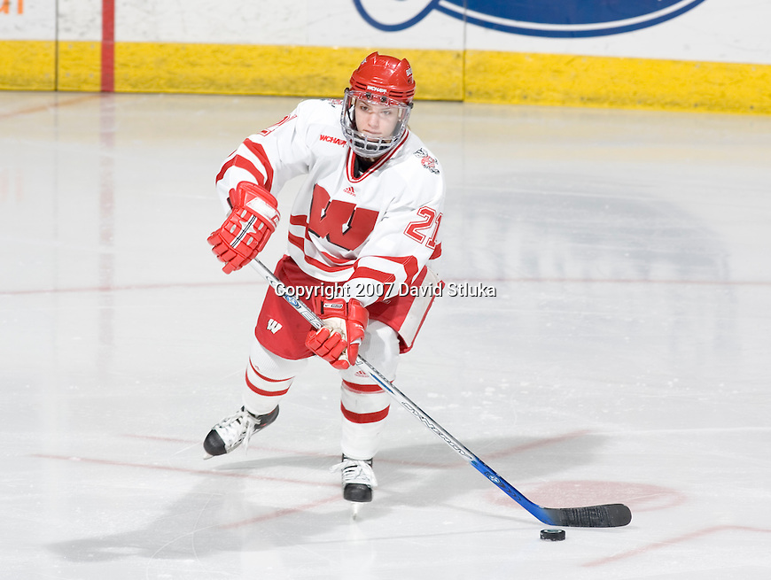 MADISON, WI - FEBRUARY 16: Angie Keseley #21 of the Wisconsin Badgers women's hockey team handles the puck against the Bemidji State Beavers at the Kohl Center on February 16, 2007 in Madison, Wisconsin. The Badgers beat the Beavers 2-0. (Photo by David Stluka)