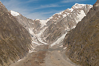 The bare rock of the Mont Blanc Massif as seen from the head of the Val Veny Tour du Mont Blanc, Italy