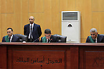 An Egyptian Judge attends the trial of ousted Egyptian president Mohammed Morsi, during the 'Qatar espionage' case, in a court in Cairo on Jan. 04, 2016. The defendants are accused of 'leaking important national security documents and information on the Egyptian armed forces' to Qatar, through the Qatari-based al-Jazeera news network. The leaks allegedly happened during Morsi's spell as president between 2012 and 2013. Photo by Stranger