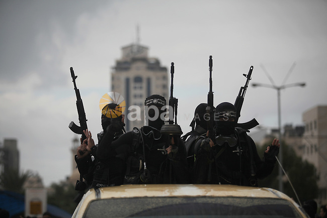 Palestinian members of the marine unit of al-Qassam Brigades, the armed wing of the Hamas movement, ride in a pickup truck as they take part in a military parade marking the 27th anniversary of Hamas' founding, in Gaza City December 14, 2014. Photo by Ashraf Amra
