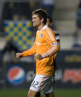 Bobby Boswell (32) of the Houston Dynamo celebrates the win after the game at PPL Park in Chester, PA.  Houston defeated Philadelphia, 2-1, to take home the one goal advantage in the home and home series..