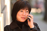 Asian woman on cell phone