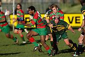 Waiuku firstfive P. Tavia makes a break past B. Feeney. Counties Manukau Premier Club Rugby, Pukekohe v Waiuku  played at the Colin Lawrie field, on the 3rd of 2006.Pukekohe won 36 - 14