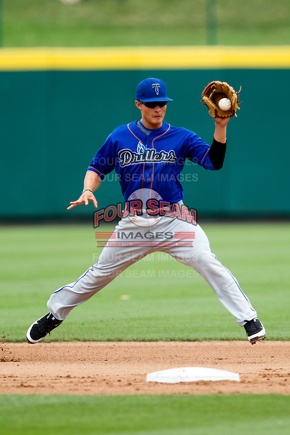 Thomas Field (2) of the Tulsa Drillers grabs a line drive to second during a game against the Springfield Cardinals at Hammons Field on June 27, 2011 in Springfield, Missouri. (David Welker / Four Seam Images)