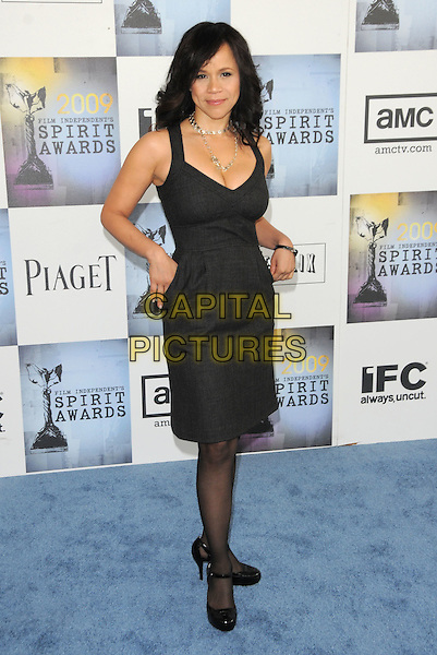 ROSIE PEREZ.The 2009 Independent Spirit Awards in Santa Monica, California, USA..February 21st, 2009.full length black dress                      .CAP/DVS.©Debbie VanStory/Capital Pictures.