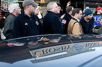 Members of the media and the public try to get a view of former Utah governor Jon Huntsman at a Jon Huntsman campaign event at Crosby's Bakery in Nashua, New Hampshire, on Jan. 9, 2012.  Hunstman is seeking the 2012 Republican presidential nomination.