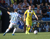 Kenny McLean on the ball as he is closed down by Chris Chantler in the Kilmarnock v St Mirren Scottish Professional Football League Premiership match played at Rugby Park, Kilmarnock on 13.9.14.