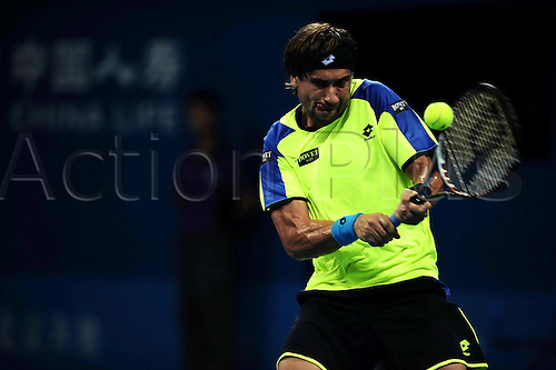 01.10.2013 Beijing, China. David Ferrer of Spain defeats Vasek Pospisil of Canada 2:1 (6-4, 3-6, 7-6) during a men's singles match at the Tennis China Open.