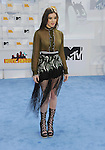 LOS ANGELES, CA - APRIL 12: Actress Hailee Steinfeld arrives at the 2015 MTV Movie Awards at Nokia Theatre L.A. Live on April 12, 2015 in Los Angeles, California.