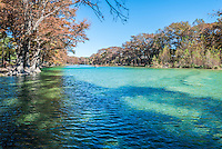 Garner State Park along the Frio River with it emerald blue waters and cypress lining up along the shore with its fall foliage.