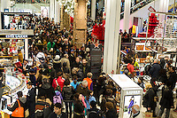 Shoppers in the Macy's Herald Square flagship store in New York looking for bargains on Black Friday, the day after Thanksgiving, Friday, November 29, 2013. Many retailers, including Macy's, opened their doors on Thanksgiving or opened up for Black Friday the night before extending the shopping day into over 24 hours. (© Frances M. Roberts)