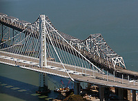 aerial photograph old and new eastern spans of San Francisco Oakland Bay Bridge