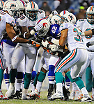 9 December 2007: Buffalo Bills rookie running back Fred Jackson is smothered with a gang tackle by the Miami Dolphins at Ralph Wilson Stadium in Orchard Park, NY. The Bills defeated the Dolphins 38-17. ..Mandatory Photo Credit: Ed Wolfstein Photo
