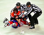 7 December 2009: Philadelphia Flyers' left wing forward Riley Cote and Montreal Canadiens right wing forward Georges Laraque are separated by the officials after a fight in the first period at the Bell Centre in Montreal, Quebec, Canada. The Canadiens defeated the Flyers 3-1. Mandatory Credit: Ed Wolfstein Photo