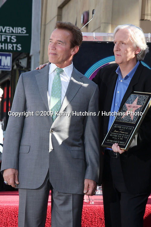 Arnold Schwarzenegger & James Cameron. at the Hollywood Walk of Fame Ceremony for James Cameron.Egyptian Theater Sidewalk.Los Angeles,  CA.December 18, 2009.©2009 Kathy Hutchins / Hutchins Photo.