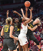 Arkansas' Taylah Thomas goes up[ for a rebound against  Missouri's Hannah Schuchts (13) Aijha Blackwell (33) and Jordan Chavis (24) Sunday Jan. 12, 2020 at Bud Walton Arena in Fayetteville. The Hogs won 90-73.  <br /> Visit http://bit.ly/35LCcWr for a gallery of the game. (NWA Democrat-Gazette/J.T. Wampler)