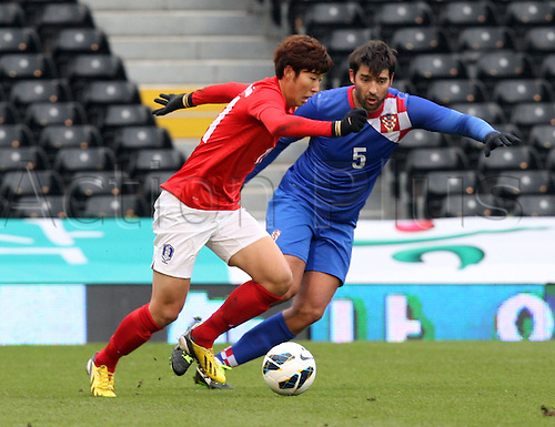 06.02.2013. London, England. South Korea's Son Heung-Min takes on Croatia's Vedran Corluka in action during International Friendly game between Croatia and South Korea from Craven Cottage.