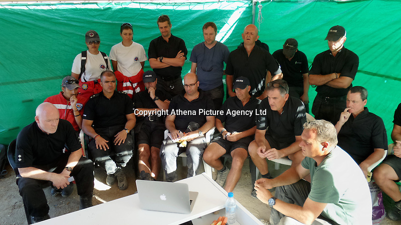 Pictured: South Yorkshire Police Detective Inspector Jon Cousins (FRONT L) watches with colleagues the video showing Kerry Needham on an ITV interview at the farmhouse site  in Kos, Greece.<br />Re: Police teams led by South Yorkshire Police are searching for missing toddler Ben Needham on the Greek island of Kos.<br />Ben, from Sheffield, was 21 months old when he disappeared on 24 July 1991 during a family holiday.<br />Digging has begun at a new site after a fresh line of inquiry suggested he could have been crushed by a digger.